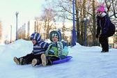 Children sledding — Stock Photo
