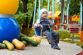 Child on a swing — Stock Photo