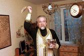 Priest consecrates the apartment — Stock Photo
