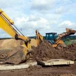 Excavator against blue sky — Stock Photo #29386867