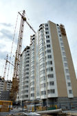 Construction of a new high rise house — Stock Photo