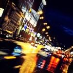 Moving car through city at night — Stock Photo #9951466
