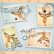 Four postage stamps with christmas theme - funny reindeer — Stock Photo