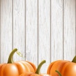 Stock Vector: Background wit orange pumpkins