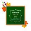 "Chalkboard sign ""back to school"" with maple leaves and ballpoint — Stock vektor"