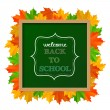 "Chalkboard sign ""back to school"" with leaves — Stok Vektör"