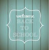 "Chalkboard sign ""back to school"" on wood — Stockvektor"