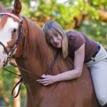 Bareback woman rider hugging her horse — Stock Photo