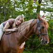 Bareback woman rider hugging her horse — Stock Photo