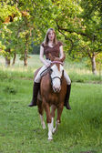 Woman riding her horse bareback — Stock Photo