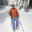 Senior man snowshoeing — Stock Photo