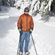 Senior man snowshoeing - Stock Photo
