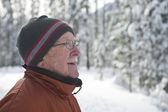Senior man in snowy winter scene — Stock Photo