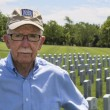 WWII veterstanding in cemetery — Stock Photo #21454397