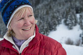 Middle aged woman in snow — Stock Photo