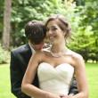 Newlyweds intimate kiss — Stock Photo #21469043