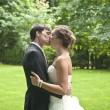 Newlyweds intimate kiss — Stock Photo