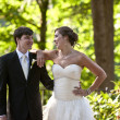 Bride and groom in forest setting — Stock Photo
