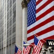 Stock Photo: Wall Street, street sign, with US flag