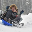 Teens sledding on a saucer — Stock Photo
