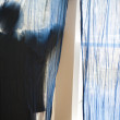 Silhouette of young man against blue curtains — Stock Photo #21595703