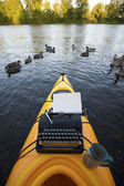Kayak with a typewriter — Stock Photo