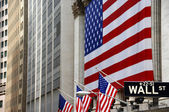 Wall Street, street sign, with US flag — Stock Photo
