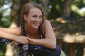 Teenage girl on a bicycle — Stock Photo