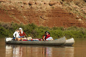 Family in canoes on a desert river — Stock Photo