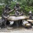 Alice in Wonderland statue, Central Park, New York City - Stock Photo