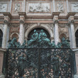 Stock Photo: Carved gate to San Marco Bell Tower, Venice