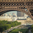 Paris seen through legs of Eiffel Tower — Stock Photo