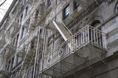 Classic old New York City apartment buildings with fire escapes — Stock Photo