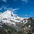 Stock Photo: Snowcapped Mount Baker under high cirrus clouds