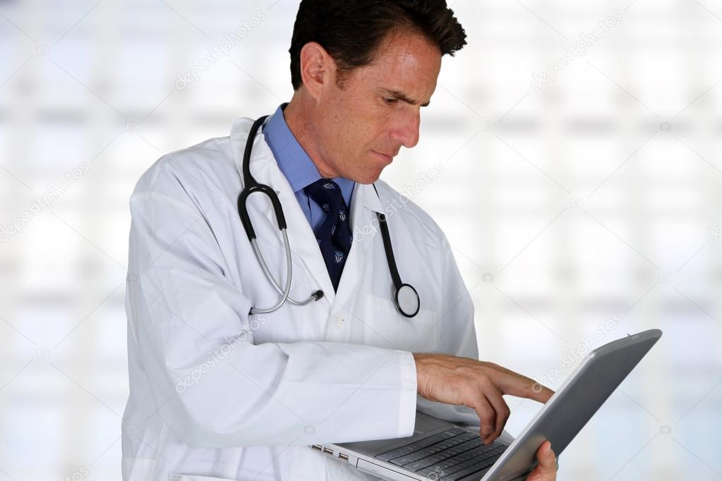 Caucasian male doctor working in a hospital — Stock Photo #13143541