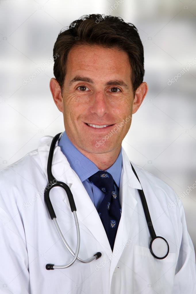 Caucasian male doctor working in a hospital  Stock Photo #13143547