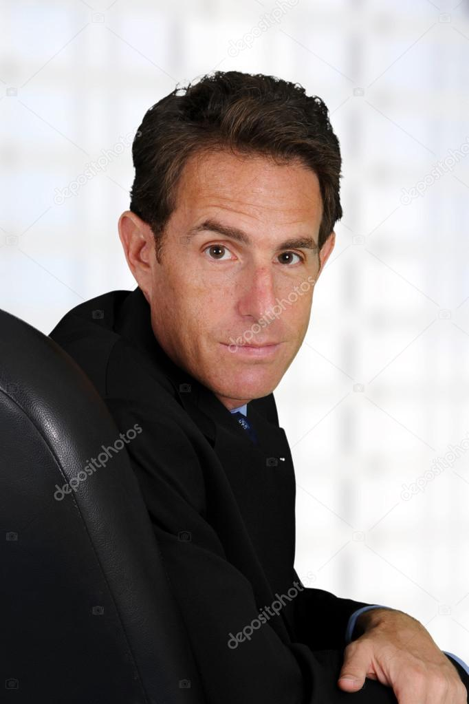 Caucasian business man working in his office — Stock Photo #13143555