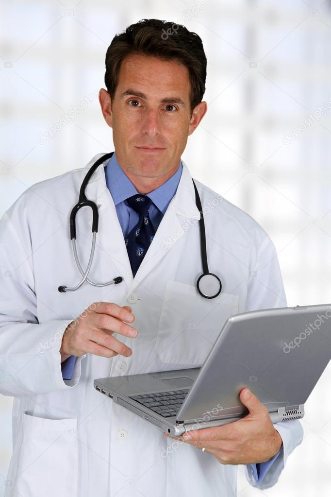 Caucasian male doctor working in a hospital — Stock Photo #13143556