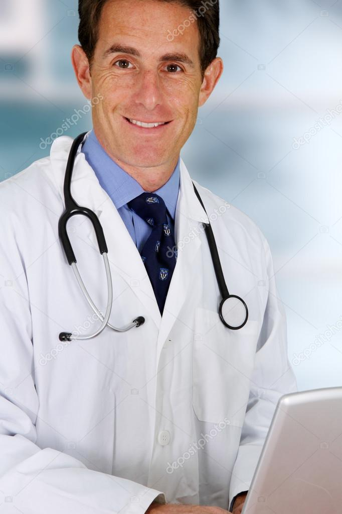 Caucasian male doctor working in a hospital — Stock Photo #13143558