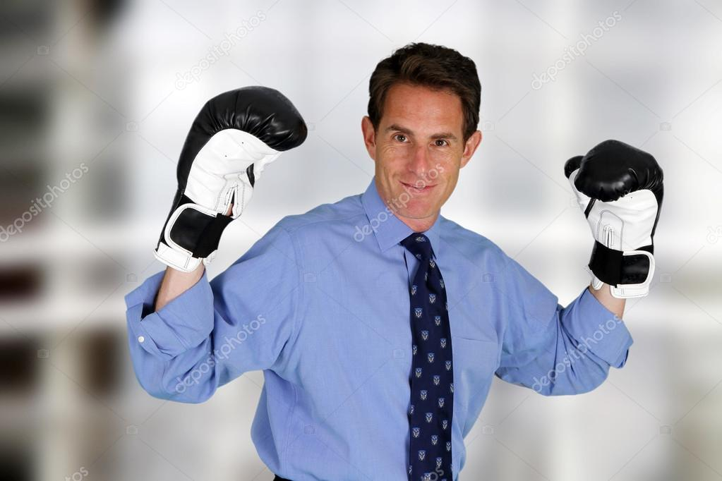 Caucasian business man working in his office  Stock Photo #13386344