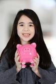 Mädchen mit bank — Stockfoto