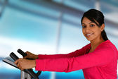 Woman Working Out On Bike — Stock Photo