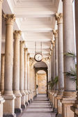 Colonnade with clock — Stok fotoğraf