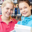 studenter i biblioteket — Stockfoto