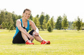 Happy woman jogger training in the park. Healthy lifestyle and p — Stock Photo