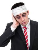 Businessman with bruised eyes and head — Stock Photo