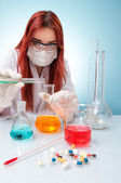 Chemist woman with test tubes — Stock Photo