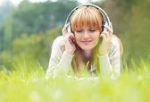 Beautiful young woman with headphones — Stock Photo