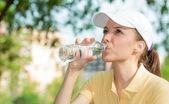 Thirsty woman drinking fresh water — Stock Photo