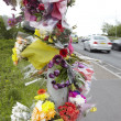 Stock Photo: Floral Tributes At Site Of Road Traffic Accident